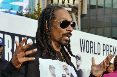 Dozens injured by collapsed railing at Snoop Dogg and Wiz Khalifa concert