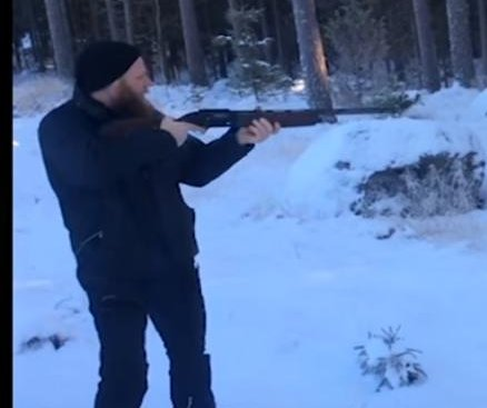 Man demonstrates how to fell tree with a shotgun