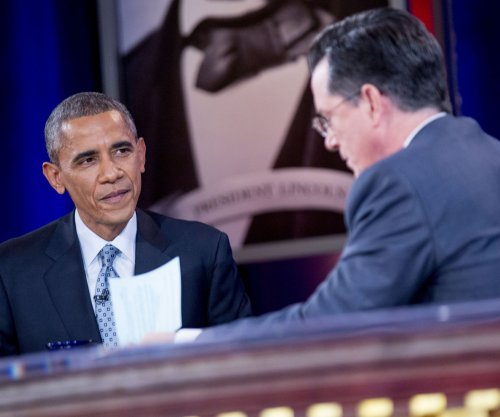 President Obama makes an appearance on 'The Colbert Report' for one of the last shows