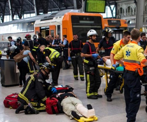 Dozens hurt in train crash at Barcelona station