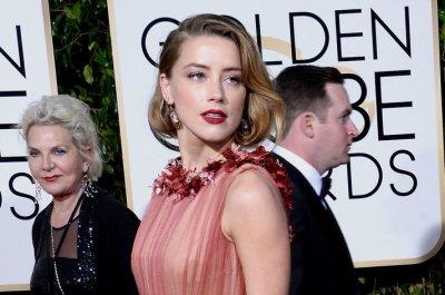 Report: Amber Heard, Elon Musk split after year of dating