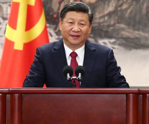 China's Communist Party sets stage for Xi to remain in power