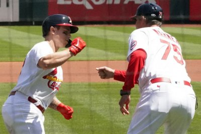 Flaherty dominant, O'Neil homers twice as Cardinals beat Reds