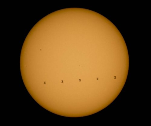 Photo shows space station traveling across sun's face