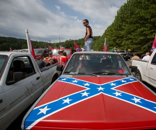Confederate flag group charged with terrorist threats