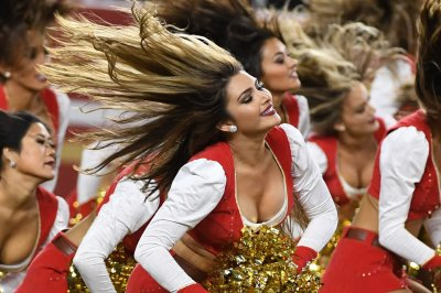 NFL cheerleader takes knee during national anthem