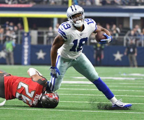 Dallas Cowboys WR Amari Cooper battling heel strain