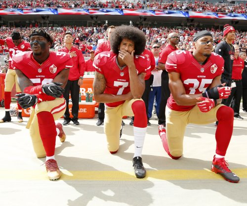 San Francisco 49ers safety Eric Reid will stand for national anthem this season