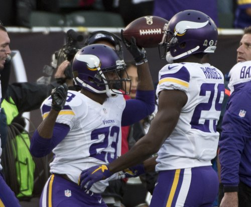 Minnesota Vikings CB Xavier Rhodes, DT Sharrif Floyd will miss game vs. Green Bay Packers