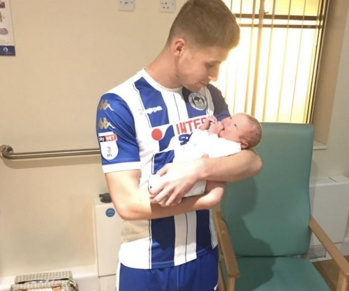 English soccer player scores two goals, leaves game for son's birth