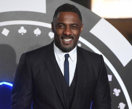 Idris Elba teases fans amid James Bond casting rumors