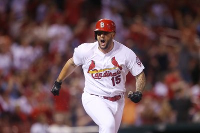 Matt Adams leads Cardinals over Giants