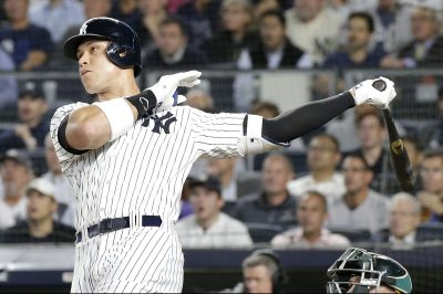 Judge powers Yanks past Oakland in AL Wild Card; Boston next