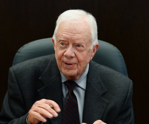 Former President Jimmy Carter says he is cancer-free
