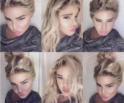 Lil' Kim shocks with blonde hair, pale complexion