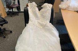 Texas tollway officials seek owner of roadside wedding dress