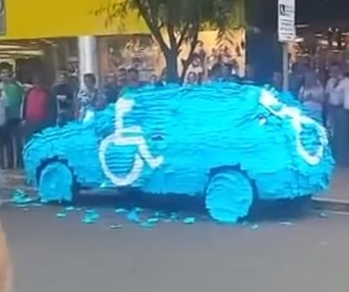 Illegally parked car covered in Post-its to draw disability symbol