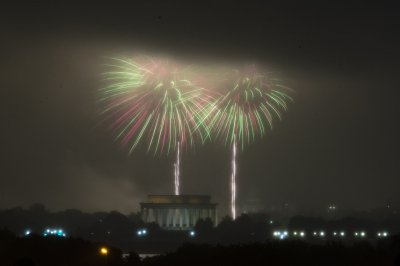 Rain fails to dampen 'Capitol Fourth' fireworks/concert as Obama's event moves indoors
