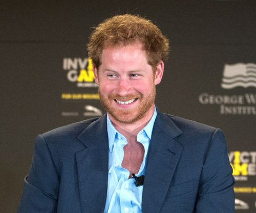 Prince Harry, Meghan Markle kiss after first public event