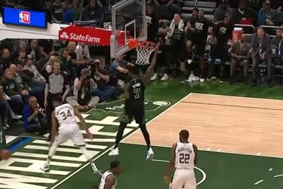 Celtics' Jaylen Brown dunks over Bucks' Giannis Antetokounmpo in Game 1 win