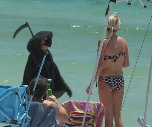 'Grim reaper' visiting Florida beaches to protest reopening