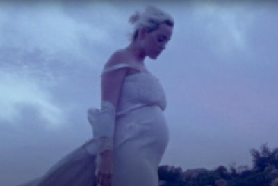Katy Perry bares baby bump in 'Daisies' music video