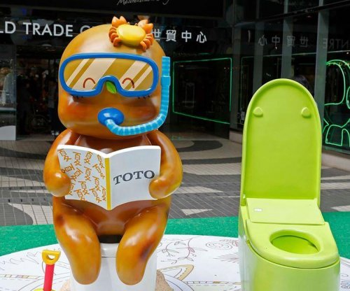 Outdoor toilet display features humanized poop character 'Excreman'