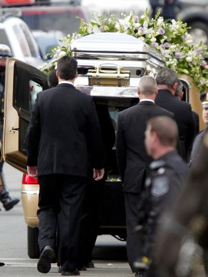 Whitney Houston laid to rest beside father