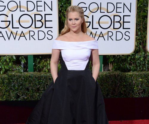 Amy Schumer, Calvin Harris win big at GQ Men of the Year Awards