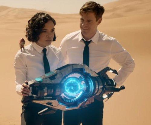 Chris Hemsworth, Tessa Thompson fight aliens in new 'Men in Black' trailer