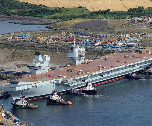 Forward island of British carrier rolled out of building hall