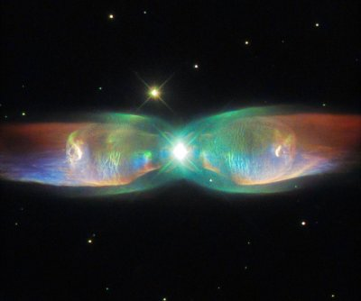 Hubble spots cosmic butterfly, wings of Twin Jet Nebula