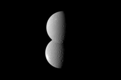 Saturn builds a headless snowman with moons Dione, Rhea