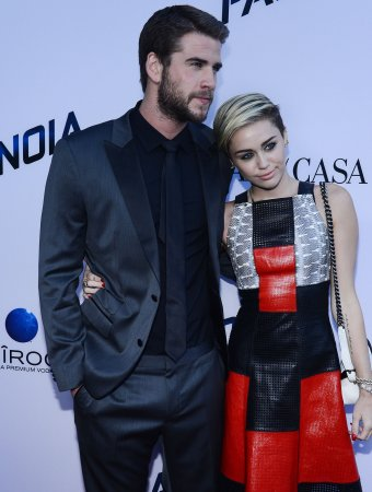 Miley Cyrus and Liam Hemsworth exchanging 'flirty' texts