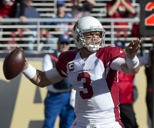 Carson Palmer scores late TD to lead Cardinals past 49ers