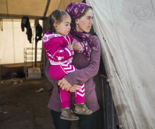 Refugee mothers, daughters seek reunion in EU