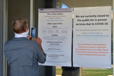 U.S. jobless claims rise by nearly 850K; unemployment ticks down