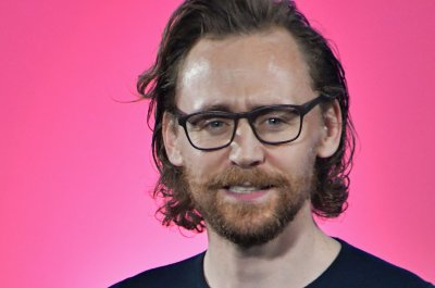 Tom Hiddleston, Henry Golding presenting at MTV Movie & TV Awards