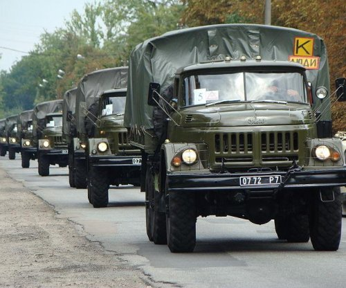 Ukraine truce pullback of weapons finally begins