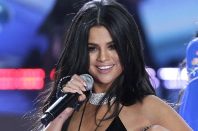 Selena Gomez, Ellie Goulding perform at Children in Need telethon, which raised $56.5M