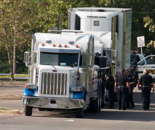 Immigrants trapped in tractor-trailer shared one air hole