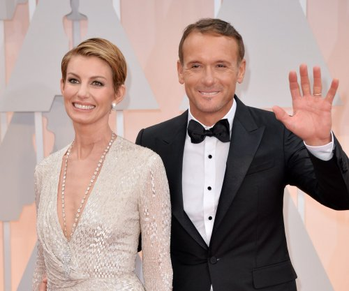 Faith Hill, Tim McGraw sport matching hair at 2015 Oscars