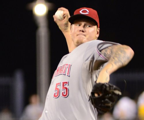 Latos seeks better results against Atlanta Braves