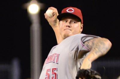 Latos seeks better results against Atlanta Braves