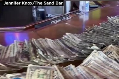 Georgia bar pays unemployed staff with dollar bills stapled to walls