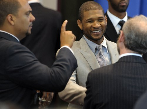 Usher's wife says divorce was a surprise