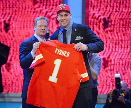 Kansas City Chiefs keep Eric Fisher; defend fifth-round pick