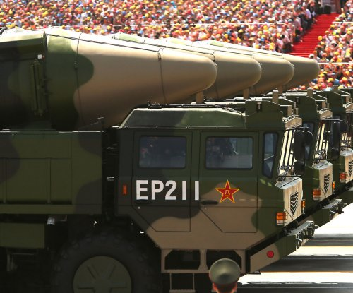 Taiwan defense minister says China missiles pose threat