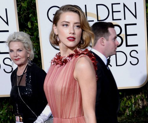 James Wan shares new photo of Amber Heard as Mera in 'Aquaman'