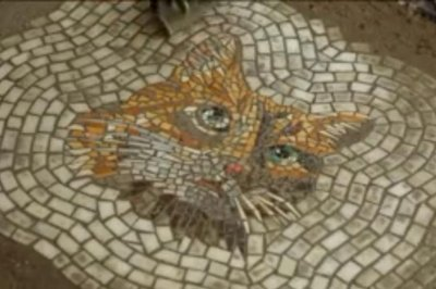 Chicago artist turns potholes into mosaic art